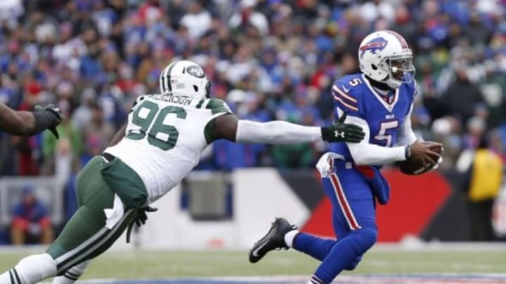 Jan 3, 2016; Orchard Park, NY, USA; New York Jets defensive end Muhammad Wilkerson (96) chases Buffalo Bills quarterback Tyrod Taylor (5) during the second half at Ralph Wilson Stadium. Bills beat the Jets 22-17. Mandatory Credit: Kevin Hoffman-USA TODAY Sports