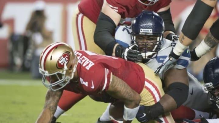 October 22, 2015; Santa Clara, CA, USA; Seattle Seahawks defensive tackle Brandon Mebane (92) sacks San Francisco 49ers quarterback Colin Kaepernick (7) during the fourth quarter at Levi