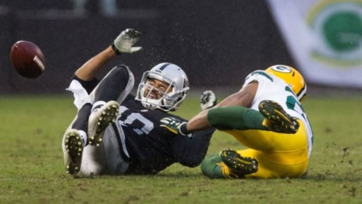 Dec 20, 2015; Oakland, CA, USA; Green Bay Packers cornerback Casey Hayward (29) prevents the pass intended for Oakland Raiders wide receiver Andre Holmes (18) during the fourth quarter at O.co Coliseum. The Green Bay Packers defeated the Oakland Raiders 30-20. Mandatory Credit: Kelley L Cox-USA TODAY Sports
