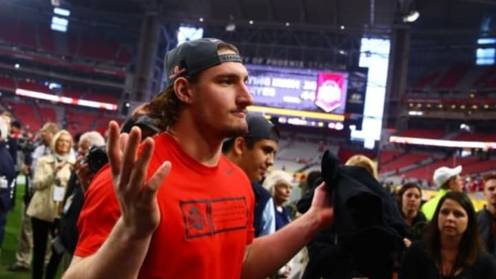 Jan 1, 2016; Glendale, AZ, USA; Ohio State Buckeyes defensive lineman Joey Bosa reacts as he walks off the field following the game against the Notre Dame Fighting Irish during the 2016 Fiesta Bowl at University of Phoenix Stadium. The Buckeyes defeated the Fighting Irish 44-28. Bosa was ejected in the first quarter for targeting. Mandatory Credit: Mark J. Rebilas-USA TODAY Sports
