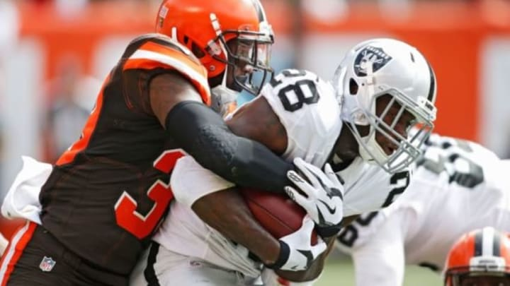 Sep 27, 2015; Cleveland, OH, USA; Cleveland Browns free safety Tashaun Gipson (39) tackles Oakland Raiders running back Latavius Murray (28) during the second quarter at FirstEnergy Stadium. Mandatory Credit: Scott R. Galvin-USA TODAY Sports