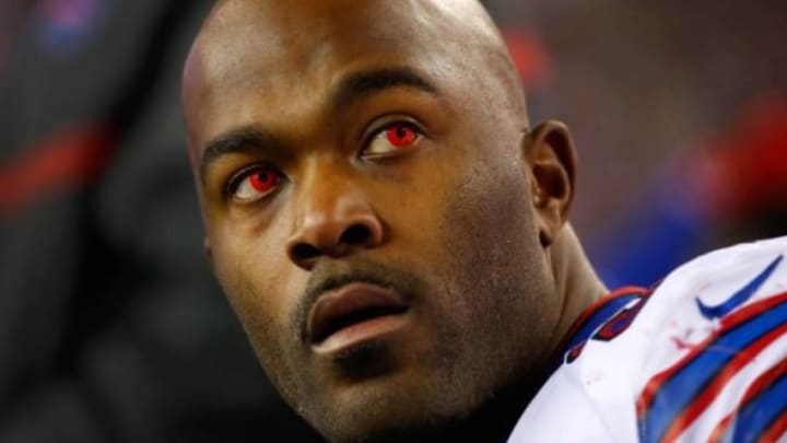 Nov 23, 2015; Foxborough, MA, USA; Buffalo Bills defensive end Mario Williams (94) looks on with red contact lenses from the bench during the first half against the New England Patriots at Gillette Stadium. Mandatory Credit: Winslow Townson-USA TODAY Sports