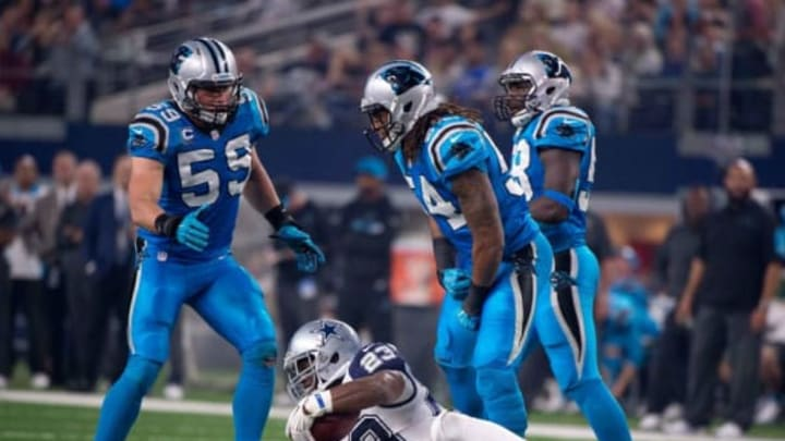 Nov 26, 2015; Arlington, TX, USA; Carolina Panthers outside linebacker Shaq Green-Thompson (54) and middle linebacker Luke Kuechly (59) celebrates Green-Thompson's tackle of Dallas Cowboys running back Robert Turbin (23) during the game on Thanksgiving at AT&T Stadium. The Panthers defeat the Cowboys 33-14. Mandatory Credit: Jerome Miron-USA TODAY Sports