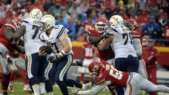 Dec 13, 2015; Kansas City, MO, USA; Kansas City Chiefs linebacker Dee Ford (55) tackled San Diego Chargers quarterback Philip Rivers (17) in the second half at Arrowhead Stadium. Kansas City won the game 10-3. Mandatory Credit: John Rieger-USA TODAY Sports