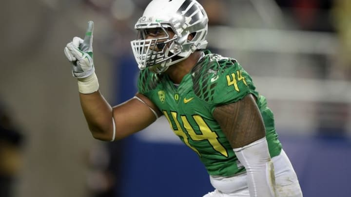 Dec 5, 2014; Santa Clara, CA, USA; Oregon Ducks defensive end DeForest Buckner (44) celebrates after a sack in the second quarter against the Arizona Wildcats in the Pac-12 Championship at Levi