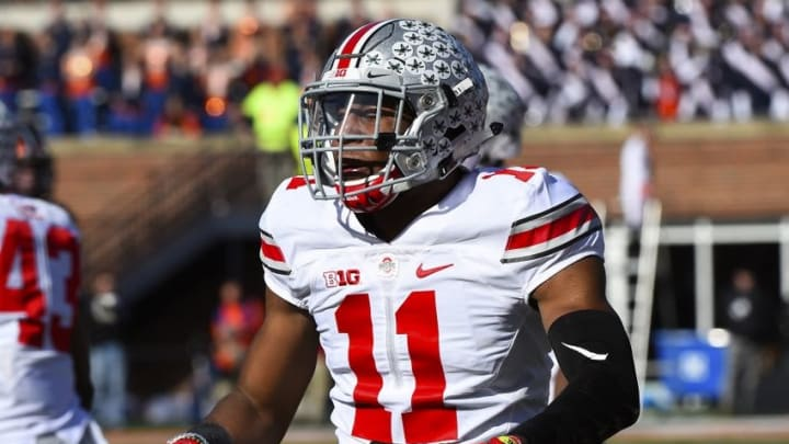 Nov 14, 2015; Champaign, IL, USA; Ohio State Buckeyes safety Vonn Bell (11) reacts after a tackle against the Illinois Fighting Illini during the second quarter at Memorial Stadium. Mandatory Credit: Mike DiNovo-USA TODAY Sports