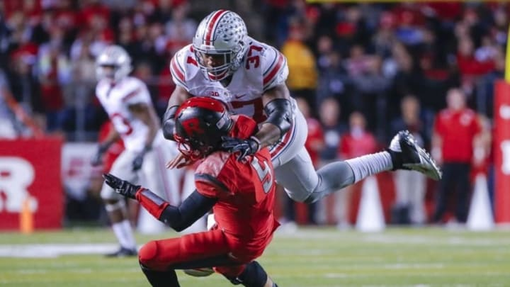 Oct 24, 2015; Piscataway, NJ, USA; Ohio State Buckeyes linebacker Joshua Perry (37) gets to Rutgers Scarlet Knights quarterback Chris Laviano (5) just as he gets rid of the ball during the second quarter at High Points Solutions Stadium. Mandatory Credit: Jim O
