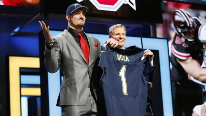 Apr 28, 2016; Chicago, IL, USA; Joey Bosa (Ohio State) with NFL commissioner Roger Goodell after being selected by the San Diego Chargers as the number three overall pick in the first round of the 2016 NFL Draft at Auditorium Theatre. Mandatory Credit: Kamil Krzaczynski-USA TODAY Sports