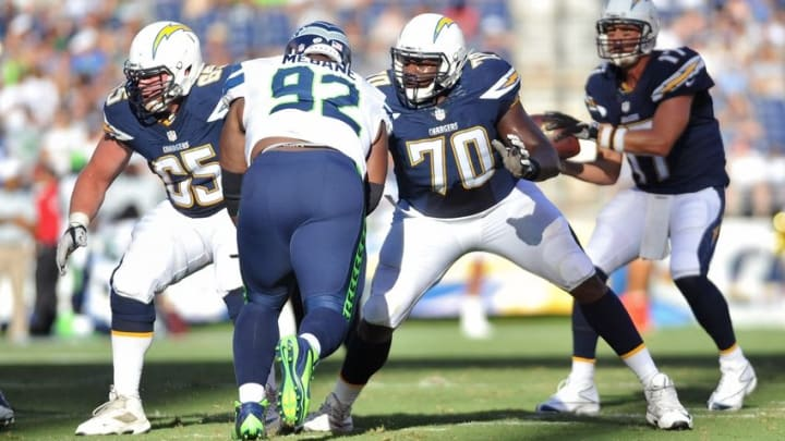 Aug 29, 2015; San Diego, CA, USA; San Diego Chargers quarterback Philip Rivers (17) is protected by center Chris Watt (65) and tackle Chris Hairston (70) who block Seattle Seahawks defensive tackle Brandon Mebane (92) at Qualcomm Stadium. Seattle won 16-15. Mandatory Credit: Orlando Ramirez-USA TODAY Sports