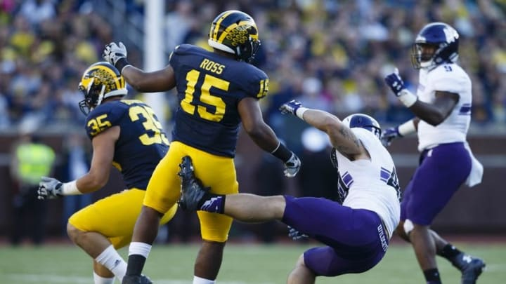 Oct 10, 2015; Ann Arbor, MI, USA; Michigan Wolverines linebacker James Ross (15) hits Northwestern Wildcats fullback Dan Vitale (40) in the third quarter at Michigan Stadium. Michigan won 38-0. Mandatory Credit: Rick Osentoski-USA TODAY Sports