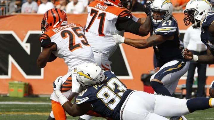 Sep 20, 2015; Cincinnati, OH, USA; San Diego Chargers defensive end Darius Philon (93) tackles Cincinnati Bengals running back Giovani Bernard (25) in the second half at Paul Brown Stadium. Cincinnati defeated San Diego 24-19. Mandatory Credit: Mark Zerof-USA TODAY Sports
