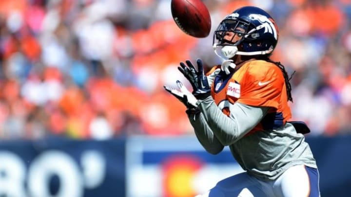Aug 2, 2014; Denver, CO, USA; Denver Broncos wide receiver Isaiah Burse (19) practices kickoff returns prior to the start of a scrimmage at Sports Authority Field. Mandatory Credit: Ron Chenoy-USA TODAY Sports