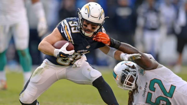 Dec 20, 2015; San Diego, CA, USA; San Diego Chargers running back Danny Woodhead (39) is tackled by Miami Dolphins middle linebacker Kelvin Sheppard (52) during the third quarter at Qualcomm Stadium. Mandatory Credit: Jake Roth-USA TODAY Sports