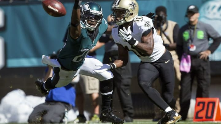 Oct 11, 2015; Philadelphia, PA, USA; New Orleans Saints wide receiver Brandin Cooks (10) makes a 25 yard reception past Philadelphia Eagles strong safety Walter Thurmond (26) during the first quarter at Lincoln Financial Field. Mandatory Credit: Bill Streicher-USA TODAY Sports
