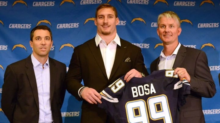 Apr 29, 2016; San Diego, CA, USA; San Diego Chargers first round draft pick Joey Bosa (C) poses for a picture with general manager Tom Telesco head coach Mike McCoy and president of a football operations John Spanos during a press conference at Chargers Park. Mandatory Credit: Jake Roth-USA TODAY Sports