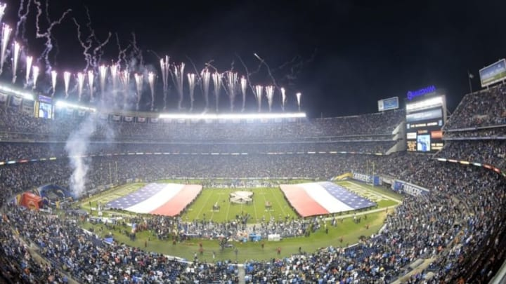 Nov 9, 2015; San Diego, CA, USA; General view of the playing of the national anthem with the NFL Salute to Service ribbon logo at midfield and fireworks before the game between the Chicago Bears and San Diego Chargers in a NFL football game at Qualcomm Stadium. Mandatory Credit: Kirby Lee-USA TODAY Sports