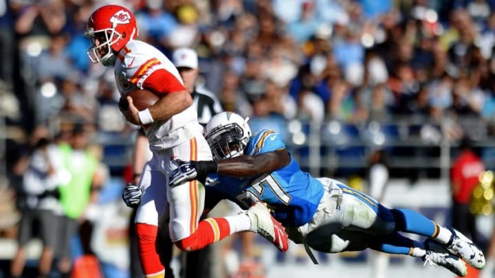 Nov 22, 2015; San Diego, CA, USA; Kansas City Chiefs quarterback Alex Smith (11) is chased down by San Diego Chargers outside linebacker Jeremiah Attaochu (97) during the second quarter at Qualcomm Stadium. Mandatory Credit: Jake Roth-USA TODAY Sports