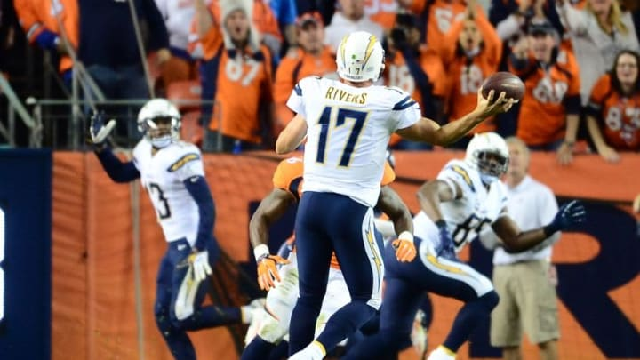 Oct 23, 2014; Denver, CO, USA; San Diego Chargers quarterback Philip Rivers (17) throws a touchdown pass to tight end Antonio Gates (85) in the third quarter against the Denver Broncos at Sports Authority Field at Mile High. The Broncos defeated the Chargers 35-21. Mandatory Credit: Ron Chenoy-USA TODAY Sports
