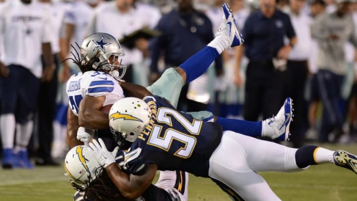 Aug 13, 2015; San Diego, CA, USA; San Diego Chargers inside linebacker Denzel Perryman (52) and defensive back Jahleel Addae (37) tackle Dallas Cowboys running back Gus Johnson (37) during the second quarter in a preseason NFL football game at Qualcomm Stadium. Mandatory Credit: Jake Roth-USA TODAY Sports