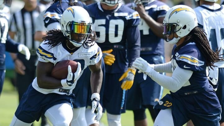Jul 30, 2016; San Diego, CA, USA; San Diego Chargers running back Melvin Gordon (left) runs as cornerback Jason Verrett (22) defends during training camp at Chargers Park. Mandatory Credit: Jake Roth-USA TODAY Sports