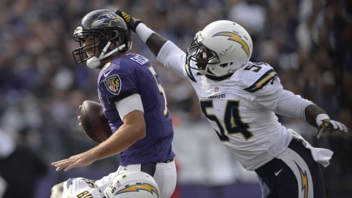 Nov 1, 2015; Baltimore, MD, USA; San Diego Chargers outside linebacker Melvin Ingram (54) leaps to sack Baltimore Ravens quarterback Joe Flacco (5) during the first quarter at M&T Bank Stadium. Mandatory Credit: Tommy Gilligan-USA TODAY Sports