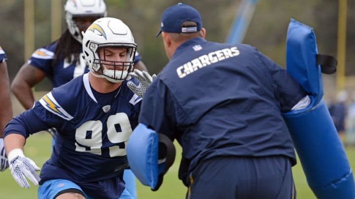 May 14, 2016; San Diego, CA, USA; San Diego Chargers defensive end Joey Bosa (L) participates in a dril during rookie minicamp at Charger Park. Mandatory Credit: Jake Roth-USA TODAY Sports