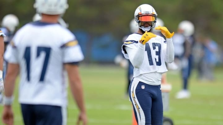 Jun 14, 2016; San Diego, CA, USA; San Diego Chargers wide receiver Keenan Allen (13) gestures to quarterback Philip Rivers (17) during minicamp at Charger Park. Mandatory Credit: Jake Roth-USA TODAY Sports