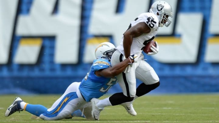 Oct 25, 2015; San Diego, CA, USA; Oakland Raiders fullback Marcel Reece (45) is tackled by San Diego Chargers inside linebacker Denzel Perryman (52) during the first quarter at Qualcomm Stadium. Mandatory Credit: Jake Roth-USA TODAY Sports