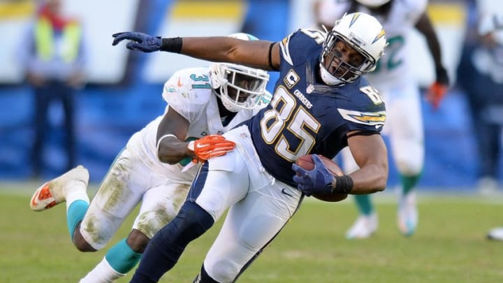 Dec 20, 2015; San Diego, CA, USA; San Diego Chargers tight end Antonio Gates (85) is defended after a catch by Miami Dolphins free safety Michael Thomas (31) during the fourth quarter at Qualcomm Stadium. Mandatory Credit: Jake Roth-USA TODAY Sports