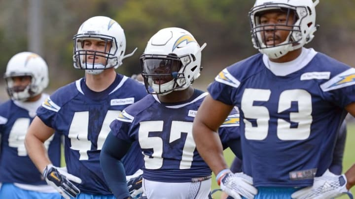 May 14, 2016; San Diego, CA, USA; San Diego Chargers linebacker Jatavis Brown (57) looks on during rookie mini camp next to Joshua Perry (53) at Charger Park. Mandatory Credit: Jake Roth-USA TODAY Sports