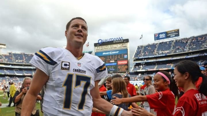 Oct 4, 2015; San Diego, CA, USA; San Diego Chargers quarterback Philip Rivers (17) celebrates a 30-27 win over the Cleveland Browns at Qualcomm Stadium. Mandatory Credit: Jake Roth-USA TODAY Sports