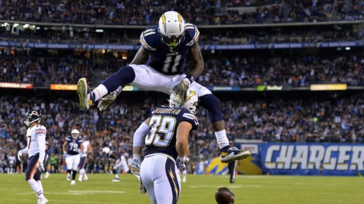 Nov 9, 2015; San Diego, CA, USA; San Diego Chargers receiver Danny Woodhead (39) celebrates with receiver Stevie Johnson (11) after scoring on a 14-yard touchdown reception in the first quarter against the Chicago Bears in a NFL football game at Qualcomm Stadium. Mandatory Credit: Kirby Lee-USA TODAY Sports