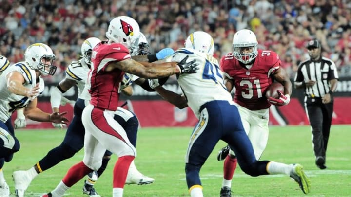 Aug 22, 2015; Glendale, AZ, USA; Arizona Cardinals running back David Johnson (31) carries the ball against the San Diego Chargers during the first half at University of Phoenix Stadium. Mandatory Credit: Joe Camporeale-USA TODAY Sports
