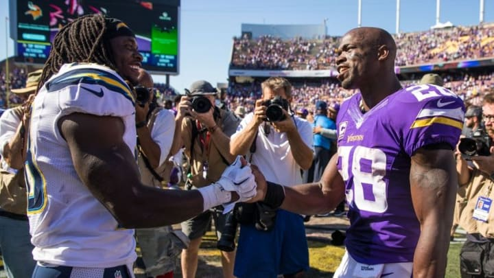 Sep 27, 2015; Minneapolis, MN, USA; Minnesota Vikings running back Adrian Peterson (28) talks with San Diego Chargers running back Melvin Gordon (28) following the game at TCF Bank Stadium. The Vikings defeated the Chargers 31-14. Mandatory Credit: Brace Hemmelgarn-USA TODAY Sports