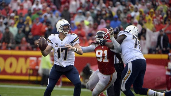 Dec 13, 2015; Kansas City, MO, USA; San Diego Chargers quarterback Philip Rivers (17) throws a pass under pressure from Kansas City Chiefs outside linebacker Tamba Hali (91) in the first half at Arrowhead Stadium. Mandatory Credit: John Rieger-USA TODAY Sports