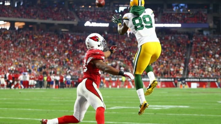 Dec 27, 2015; Glendale, AZ, USA; Green Bay Packers wide receiver James Jones (89) catches a touchdown pass against Arizona Cardinals cornerback Justin Bethel in the second half at University of Phoenix Stadium. The Cardinals defeated the Packers 38-8. Mandatory Credit: Mark J. Rebilas-USA TODAY Sports