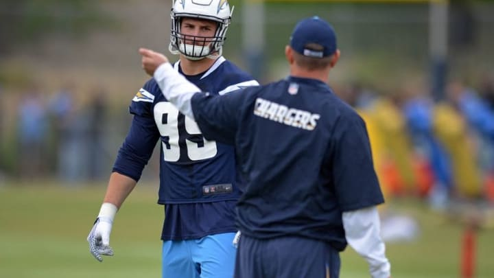 May 14, 2016; San Diego, CA, USA; San Diego Chargers defensive end Joey Bosa (99) listens to defensive line coach Giff Smith at Charger Park. Mandatory Credit: Jake Roth-USA TODAY Sports