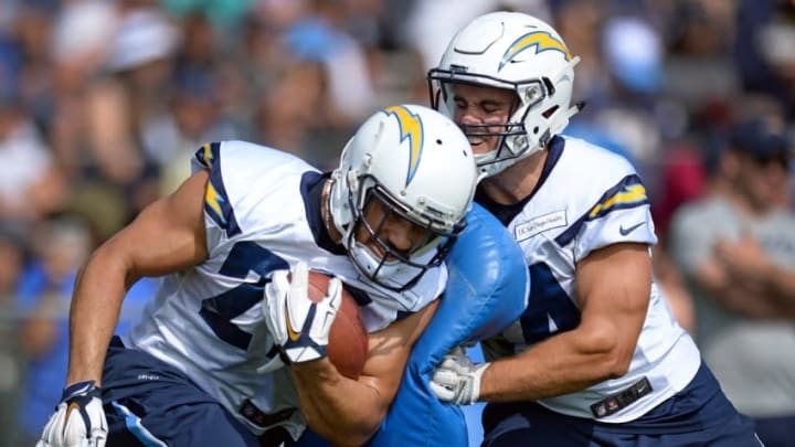 Jul 30, 2016; San Diego, CA, USA; San Diego Chargers running back Kenneth Farrow (L) participates in a drill with San Diego Chargers fullback Derek Watt (34) during training camp at Chargers Park. Mandatory Credit: Jake Roth-USA TODAY Sports