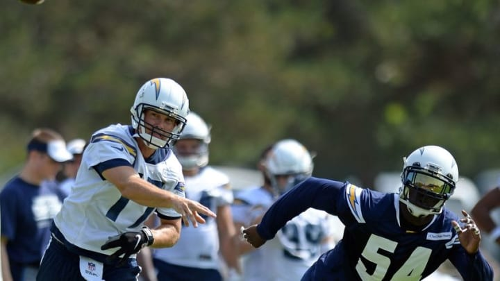 Jul 30, 2016; San Diego, CA, USA; San Diego Chargers quarterback Philip Rivers (17) passes as outside linebacker Melvin Ingram (54) defends during training camp at Chargers Park. Mandatory Credit: Jake Roth-USA TODAY Sports