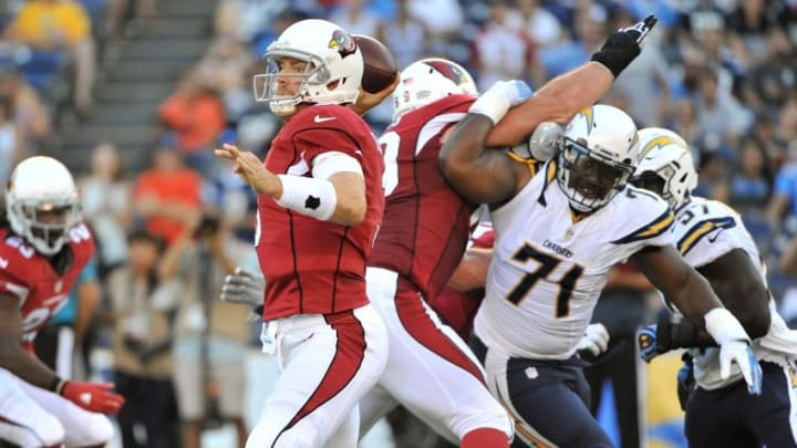 Aug 19, 2016; San Diego, CA, USA; Arizona Cardinals quarterback Carson Palmer (3) throws a pass as San Diego Chargers nose tackle Damion Square (71) rushes during the first quarter of the game at Qualcomm Stadium. Mandatory Credit: Orlando Ramirez-USA TODAY Sports