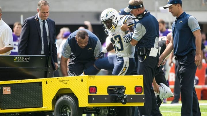 Aug 28, 2016; Minneapolis, MN, USA; San Diego Chargers running back Branden Oliver (43) is helped onto the cart after being injured during a play in the second quarter during a preseason game against the Minnesota Vikings at U.S. Bank Stadium. Mandatory Credit: Brace Hemmelgarn-USA TODAY Sports