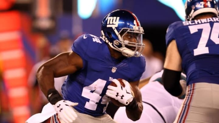 Aug 22, 2015; East Rutherford, NJ, USA; New York Giants running back Andre Williams (44) rushes the ball during the first half against the Jacksonville Jaguars at MetLife Stadium. Mandatory Credit: Danny Wild-USA TODAY Sports