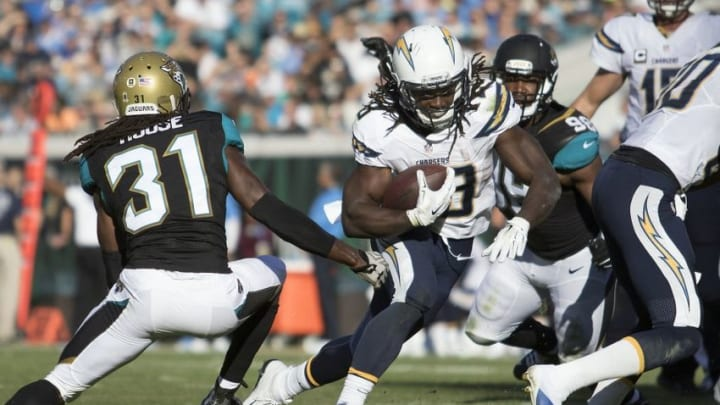 Nov 29, 2015; Jacksonville, FL, USA; [San Diego Chargers running back Melvin Gordon (28) runs as Jacksonville Jaguars cornerback Davon House (31) defends in the third quarter at EverBank Field. The San Diego Chargers won 31-24. Mandatory Credit: Logan Bowles-USA TODAY Sports
