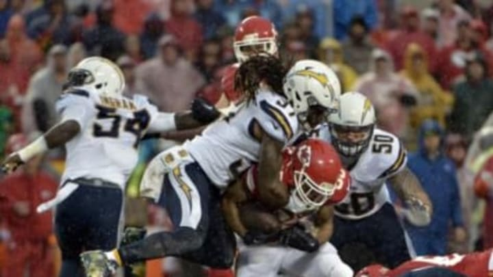 Dec 13, 2015; Kansas City, MO, USA; Kansas City Chiefs running back Charcandrick West (35) is tackled by San Diego Chargers strong safety Jahleel Addae (37) during the first half at Arrowhead Stadium. Mandatory Credit: Denny Medley-USA TODAY Sports