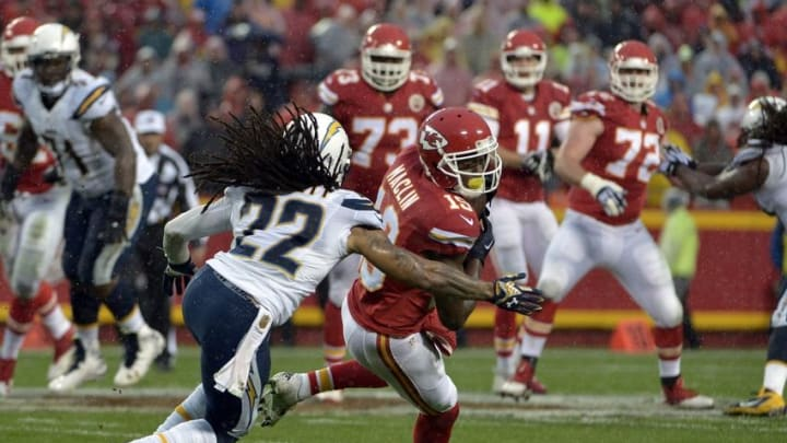 Dec 13, 2015; Kansas City, MO, USA; Kansas City Chiefs wide receiver Jeremy Maclin (19) catches a pass and is tackled by San Diego Chargers cornerback Jason Verrett (22) during the first half at Arrowhead Stadium. Mandatory Credit: Denny Medley-USA TODAY Sports