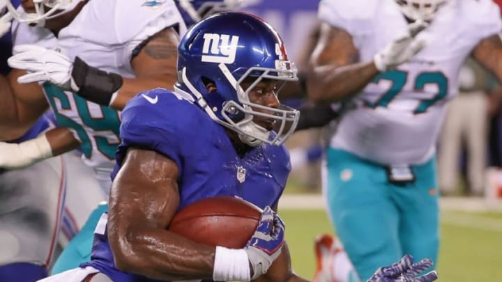 Aug 12, 2016; East Rutherford, NJ, USA; New York Giants running back Andre Williams (44) rushes the ball against the Miami Dolphins during the first half of the preseason game at MetLife Stadium. Mandatory Credit: Vincent Carchietta-USA TODAY Sports