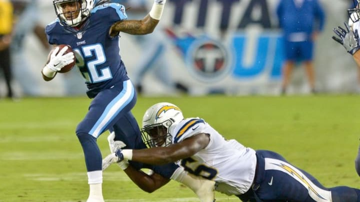 Aug 13, 2016; Nashville, TN, USA; Tennessee Titans running back Dexter McCluster (22) is tackled by San Diego Chargers linebacker Chris Landrum (46) during the first half at Nissan Stadium. Mandatory Credit: Jim Brown-USA TODAY Sports