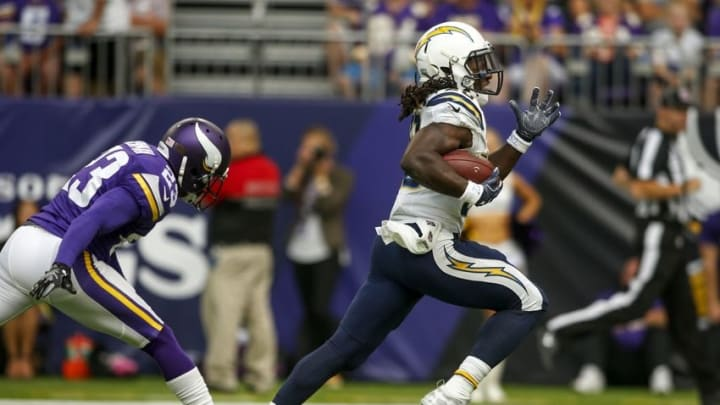 Aug 28, 2016; Minneapolis, MN, USA; San Diego Chargers running back Melvin Gordon (28) carries the ball to score a touchdown past Minnesota Vikings cornerback Terence Newman (23) in the second quarter at U.S. Bank Stadium. Mandatory Credit: Bruce Kluckhohn-USA TODAY Sports