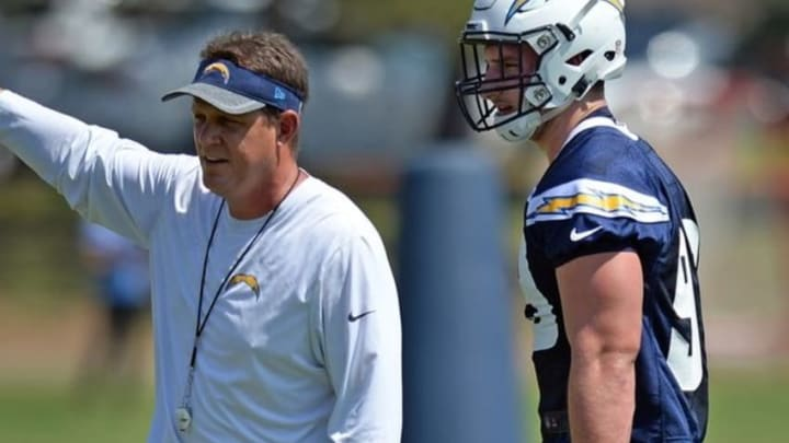 Aug 30, 2016; San Diego, CA, USA; San Diego Chargers defensive lineman Joey Bosa (99) listens to defensive line coach Giff Smith (L) during practice at Charger Park. Mandatory Credit: Jake Roth-USA TODAY Sports