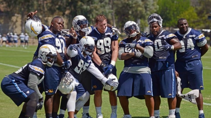 Aug 30, 2016; San Diego, CA, USA; San Diego Chargers defensive lineman Joey Bosa (99) poses for a photo with teammates during practice at Charger Park. Mandatory Credit: Jake Roth-USA TODAY Sports